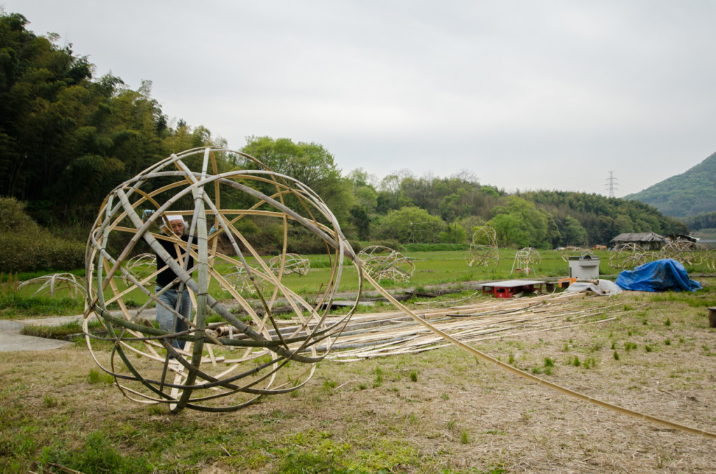 Rice farmer and artist, Hiromu Kohno works on an art installation in his field in Shikoku, Japan